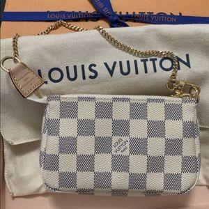 Louis Vuitton Mini pochette accessories DA